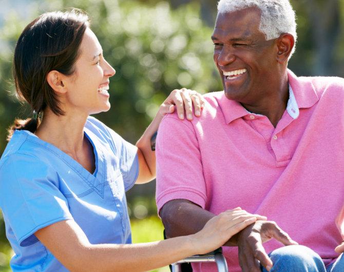 caregiver talking to elderly man