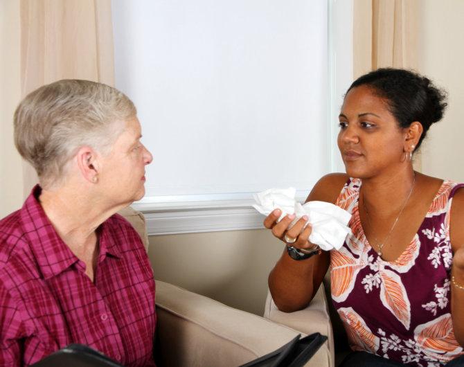 caregiver talking senior woman