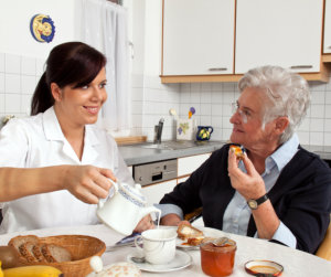 caregiver is preparing meal for her patient