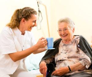caregiver is preparing tea for her patient